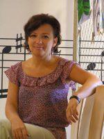 Bc. Eva Regináčová - ředitelka školy - hra na klavír, sborový zpěv